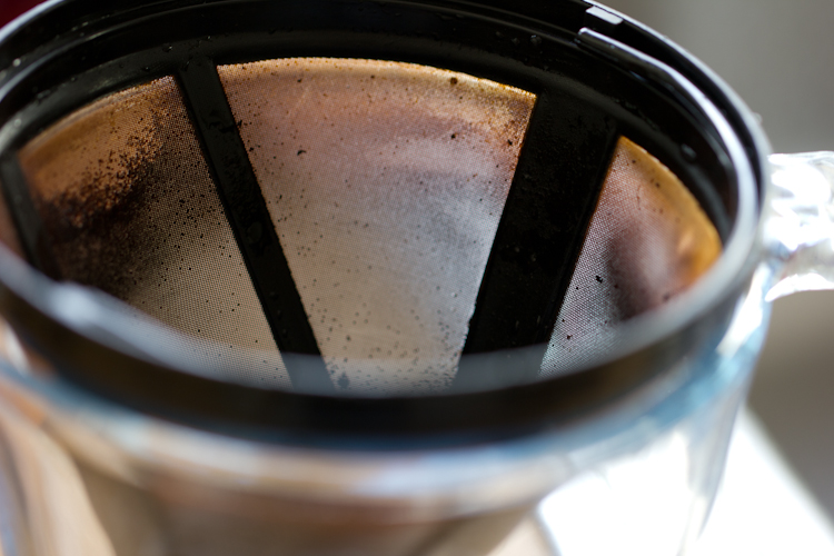 Maturing Coffee in Strainer for Coffee and Cognac Cupcakes
