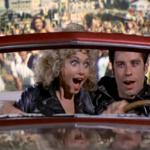 Sandy Olsson & Danny Zuko in Grease in Red Car