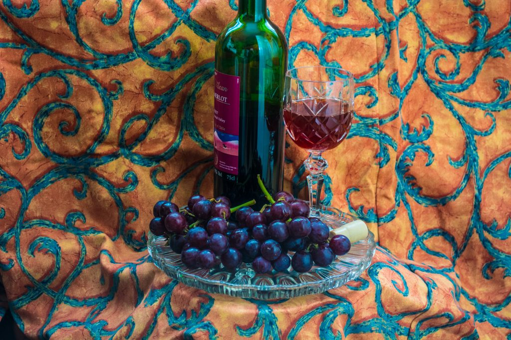 Bottle of Merlot with Glass and Grapes