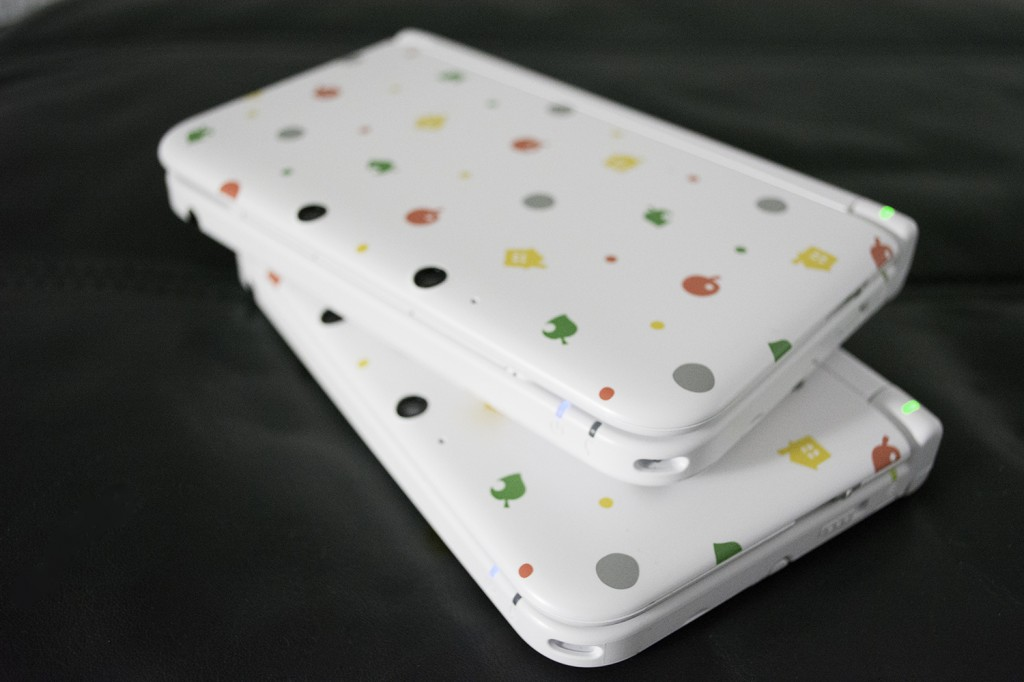Animal Crossing Nintendo 3DS XL On Top Of Each Other At An Angle