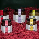 Jars of Galloway Lodge Preserves on Shredded Red Packaging