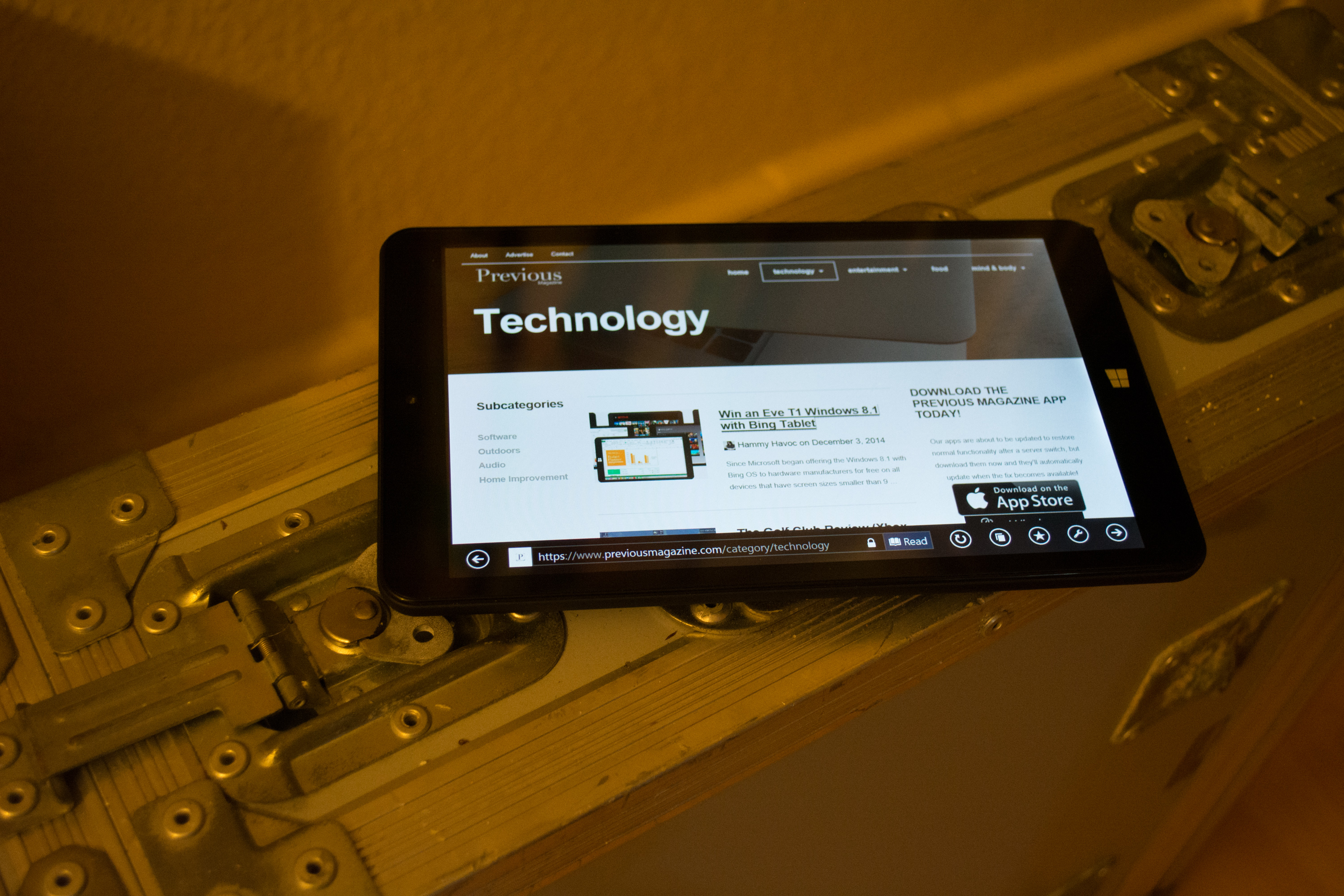 Eve T1 tablet showing the Previous Magazine website on top of flightcase