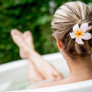 Lady Relaxing in Bath Tub Outside