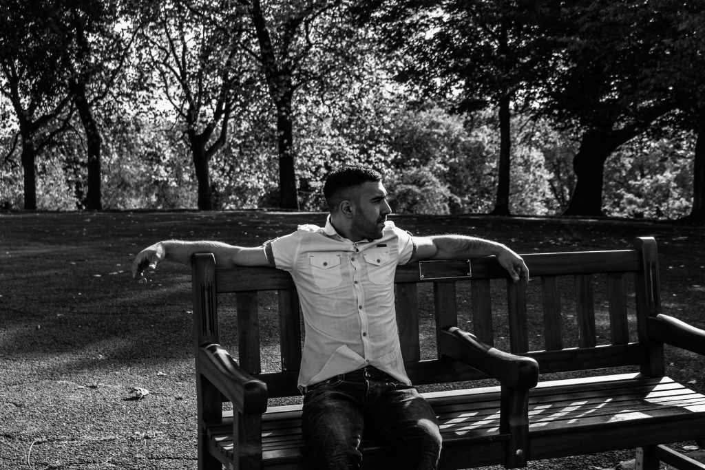 Kaz Azim Sitting on Park Bench