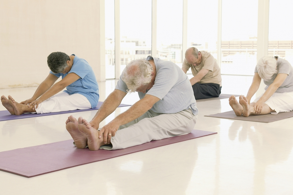 Elderly People Doing Yoga on Mats