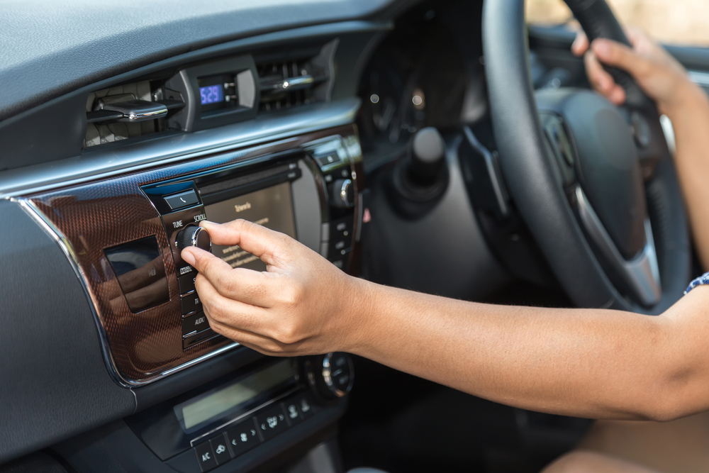 Woman Tuning Car Radio
