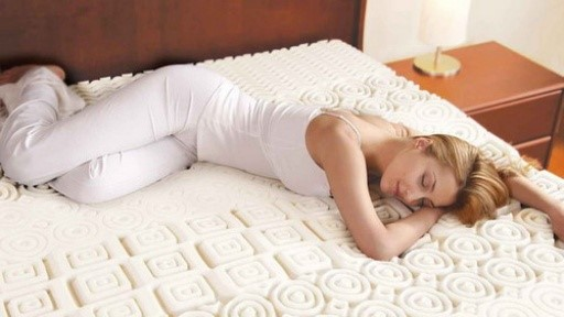Blonde Woman Sleeping on Mattress