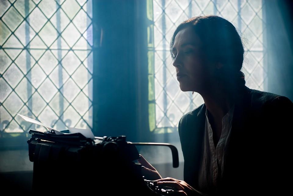 Female Writer Working at Typewriter