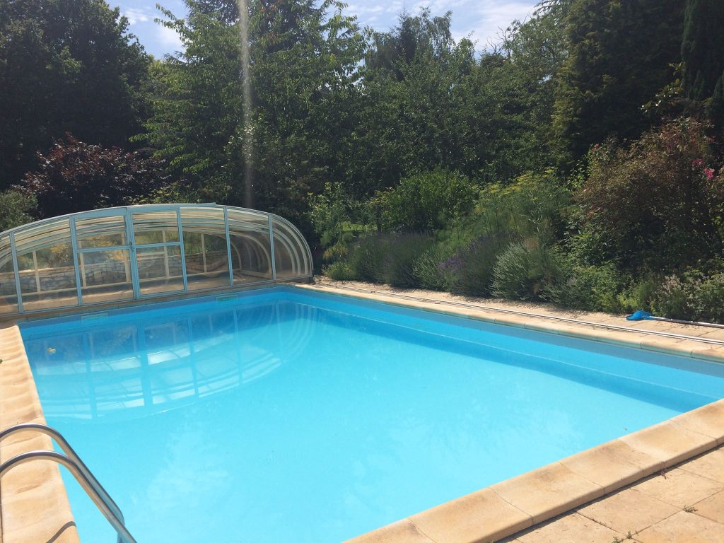 Swimming Pool in France with Sliding Glass Cover with Door