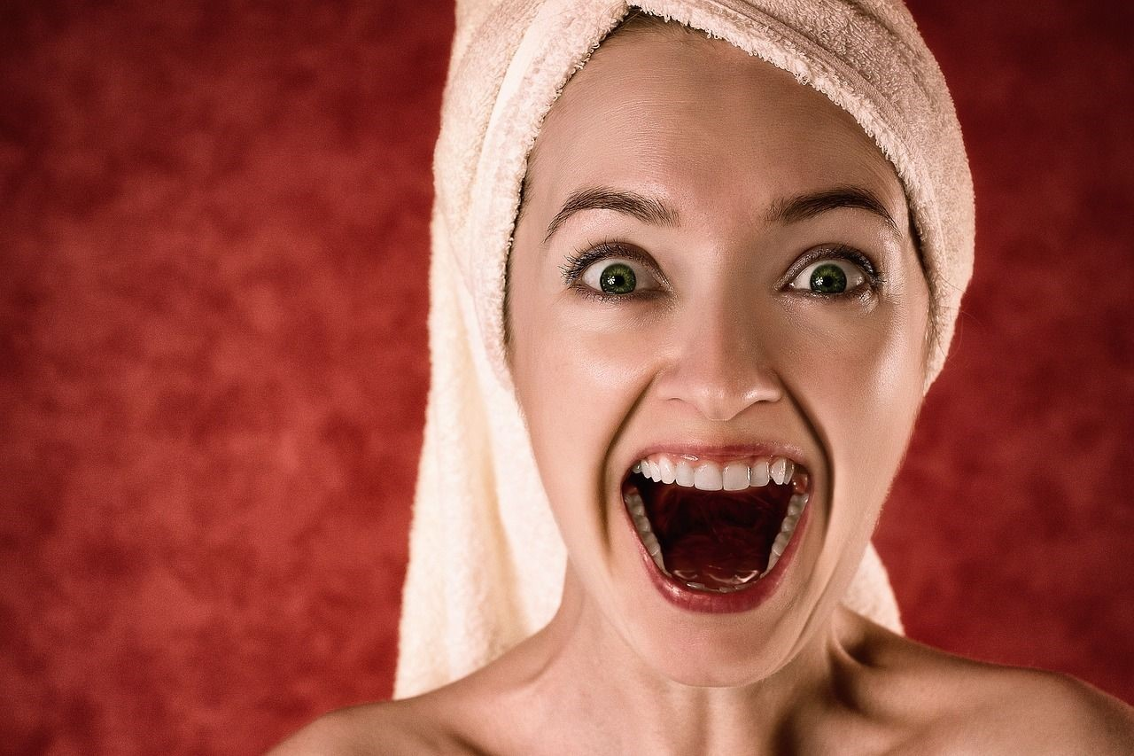 Smiling Woman with Towel Wrapped Around Hair