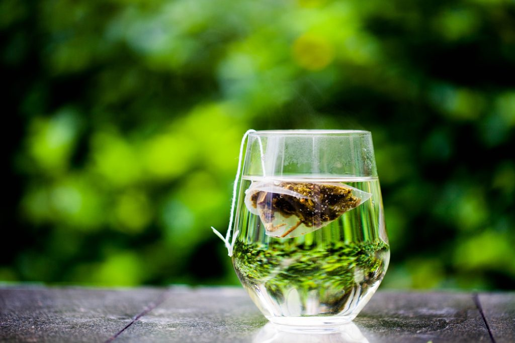 Green Tea Bag in Glass