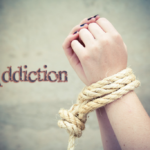 Addiction - bound hands with rope