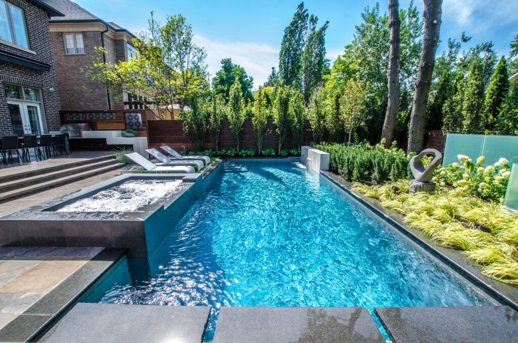 Hot tub next to swimming pool in suburban backyard