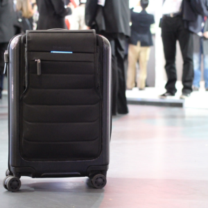 Suitcase with wheels at airport