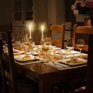 Cozy kitchen with table set for dinner