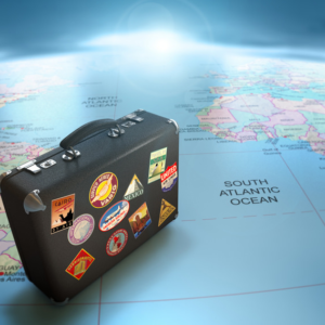 Suitcase on a world map