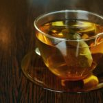 Teabag in glass cup and saucer