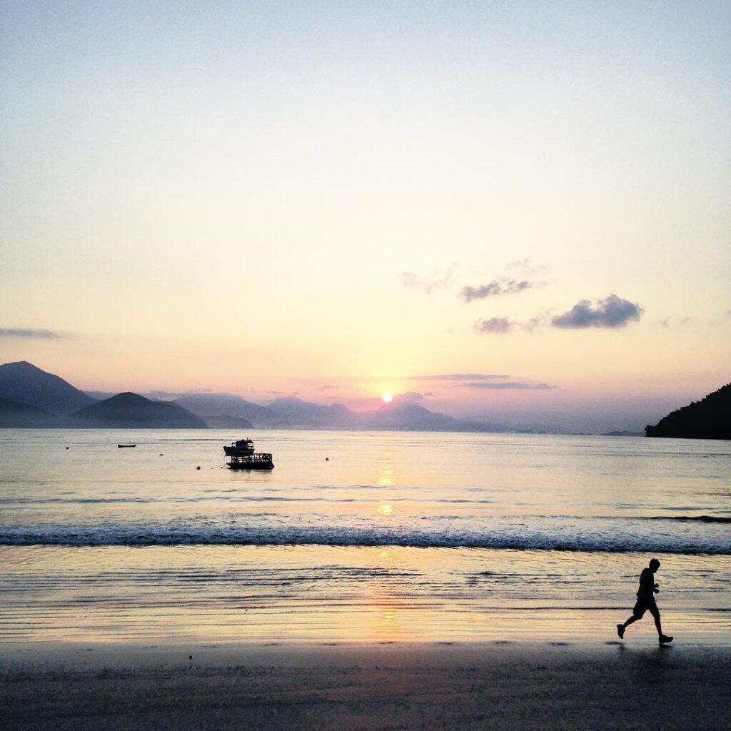 Running along the beach at sunrise