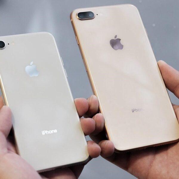iPhones in hands