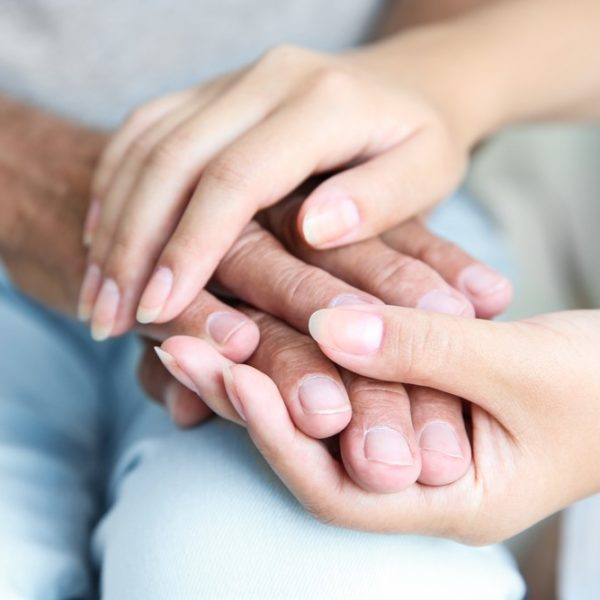 Old hands held by young hands