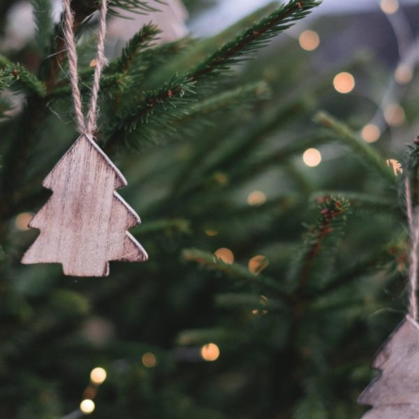 Ornaments hanging on a real Christmas tree