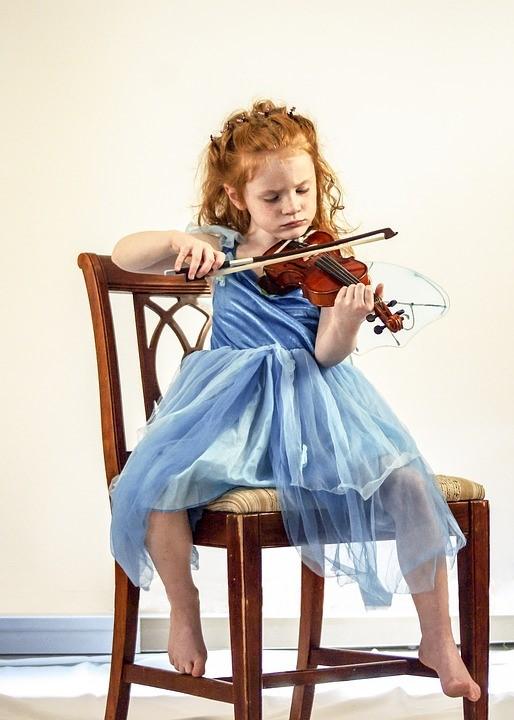 Young girl playing violin