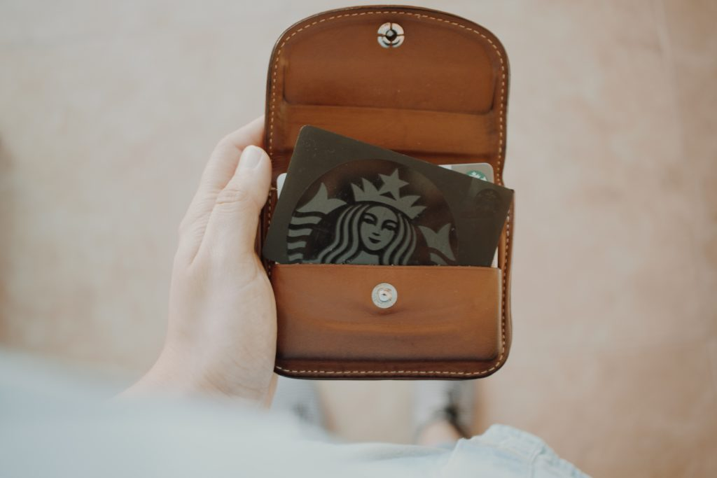 Starbucks gift card inside brown leather wallet