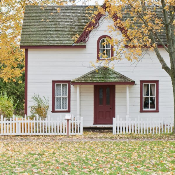Cute house with white fence