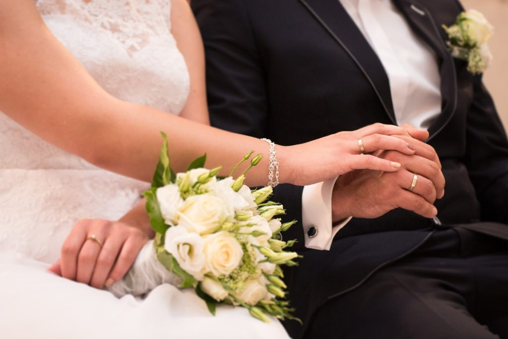 Bride holding groom's hand