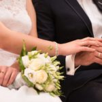 Bride holding groom's hand