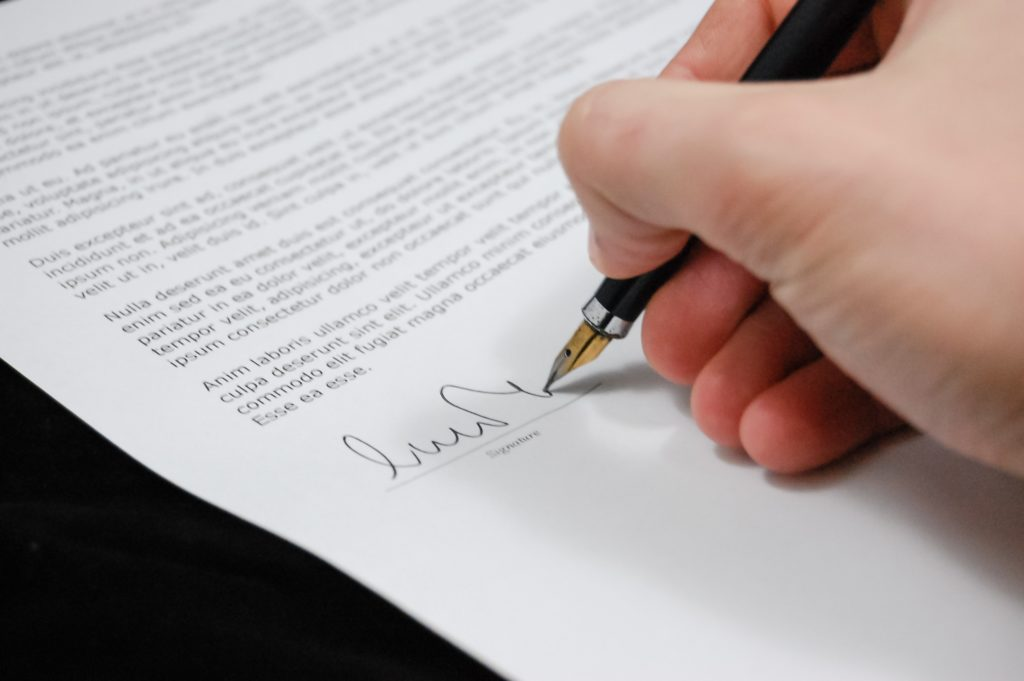 Close up of contract being signed