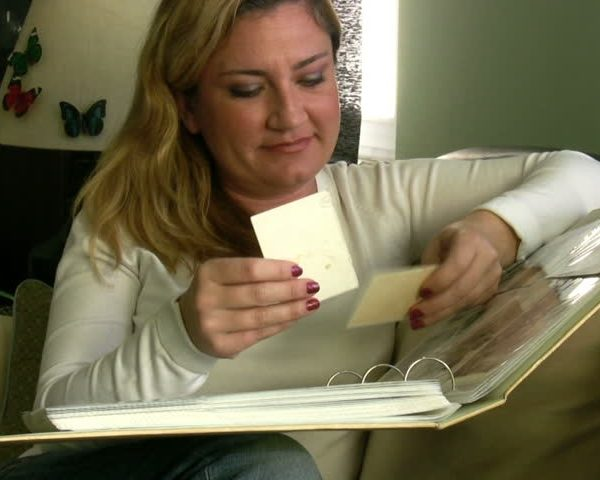Woman looking through photographs