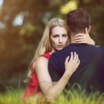 Woman caught cuddling man