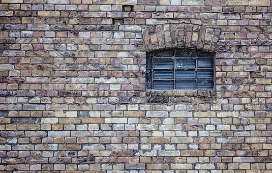 Brick wall with window in