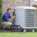 Contractor working on AC unit