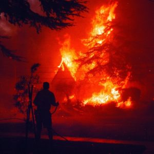 Firefighter in front of blaze
