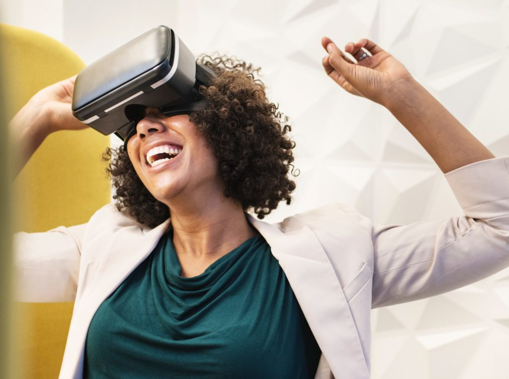 Woman smiling using virtual reality goggles