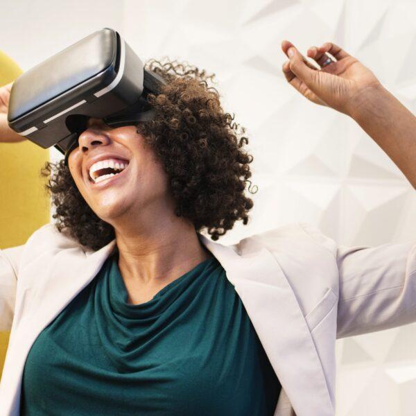 Woman smiling using virtual reality goggles