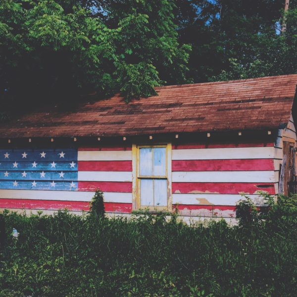 Wooden house painted with American flag