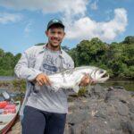 Alex Arjoon holding fish
