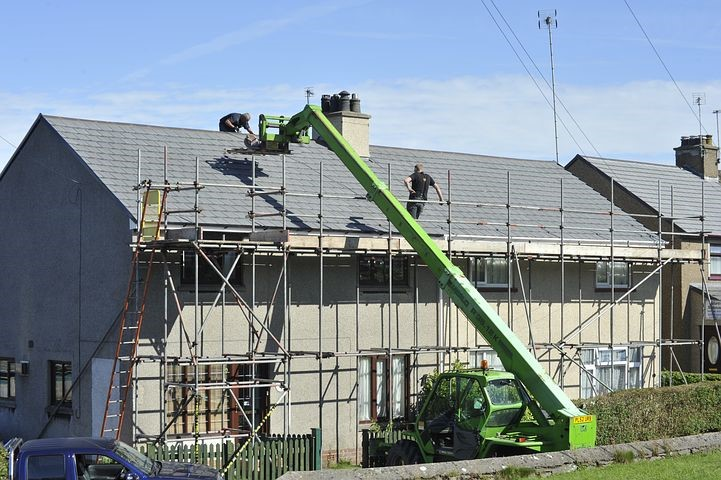 Roofing contractors working on roof