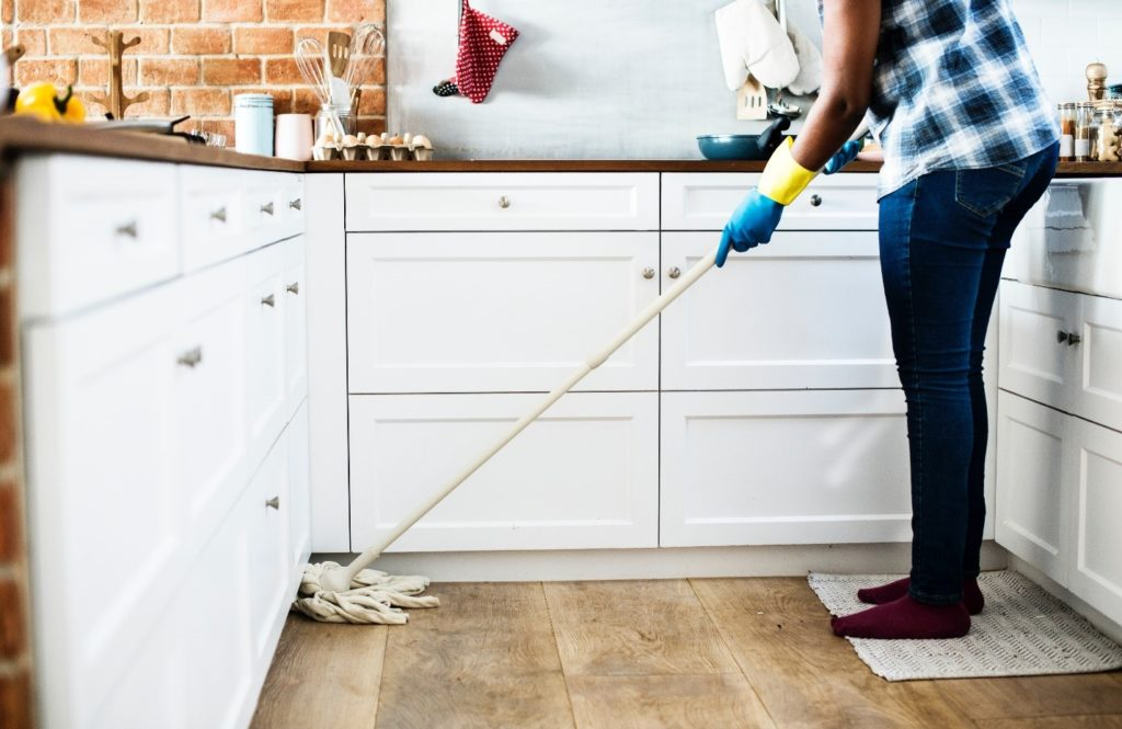 Person mopping kitchen floor