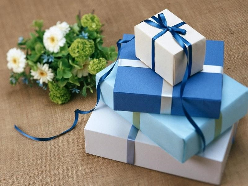 Stacked gifts and flowers