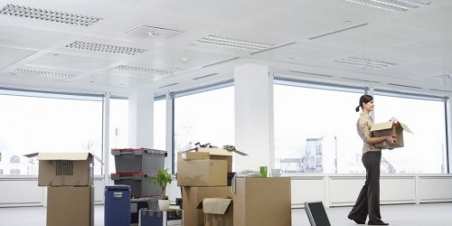Woman holding a box in an office