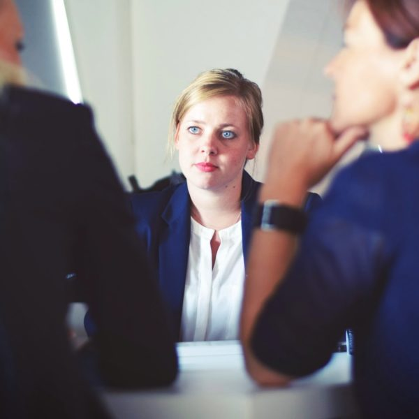 Three women in suits in meeting