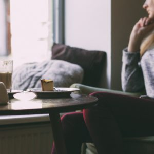 Woman sat with coffee and cake