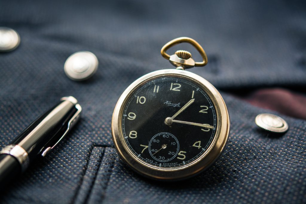 Pocket watch and pen on blazer