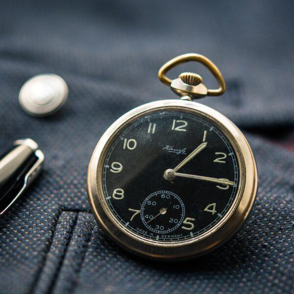 Pocket watch and pen on blazer