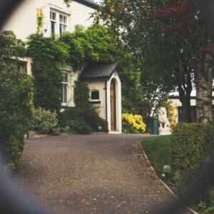 House through a chain link fence
