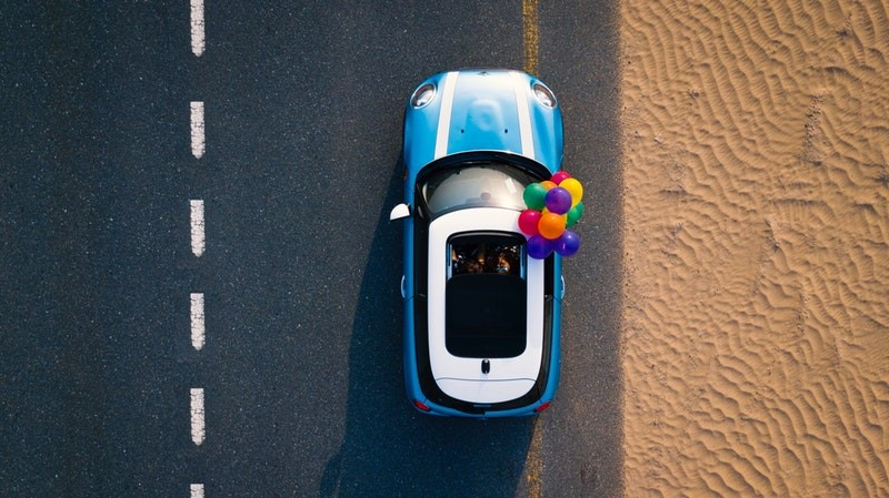 Aerial photography of car with balloons